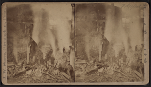 Men looking at smoking ruins after a fire. Photographer: Storrs, J. W. (John W.). This media file is in the public domain in the United States.